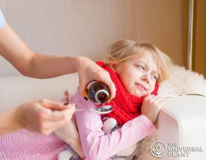 Mother gives cbd syrup to a child.